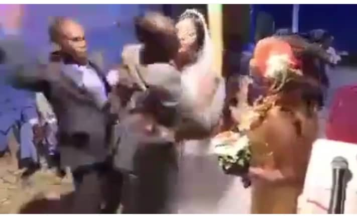 Groom slaps his bestman for hugging his wife unknown to him he was the brides ex-boyfriend(photos)