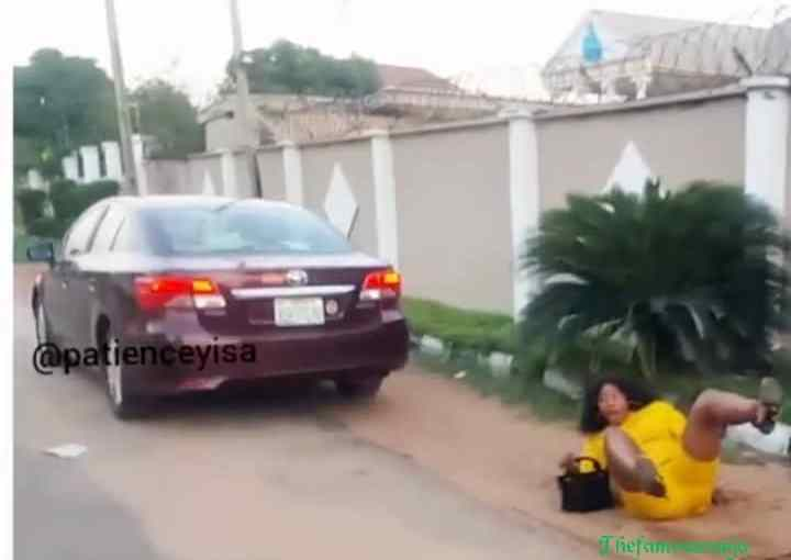 JUST IN!!! Most beautiful instagram slay queen falls after the car she was resting on to take selfie drives away (photos)