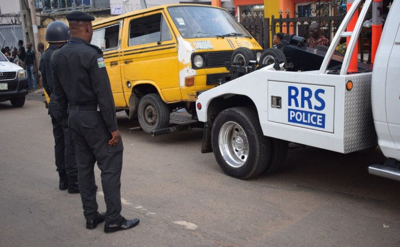 Danfo driver caught by RRS patrol officers, stripes himself naked and runs away (photos)