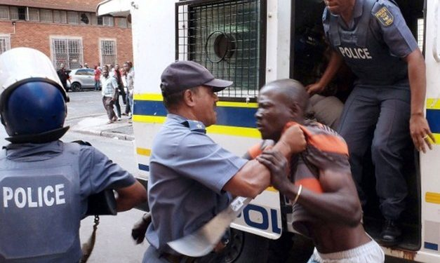 South African Police tortures a Nigerian Man to death