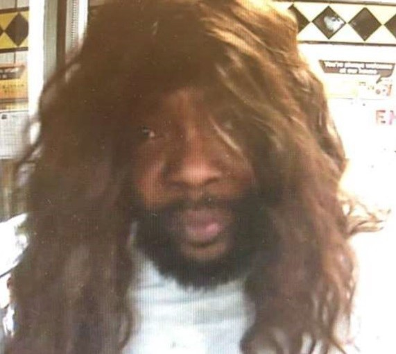Wig-wearing serial robber, wanted by the police