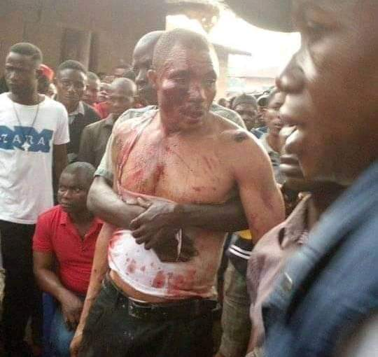 Angry Cross River Youths, beats a fake Pastor to pulp, burns his house and church(photos)