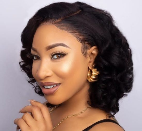 Tonto Dikeh fulfils her promise to her dad,  Buys Iphone 11 Pro for him(photos)